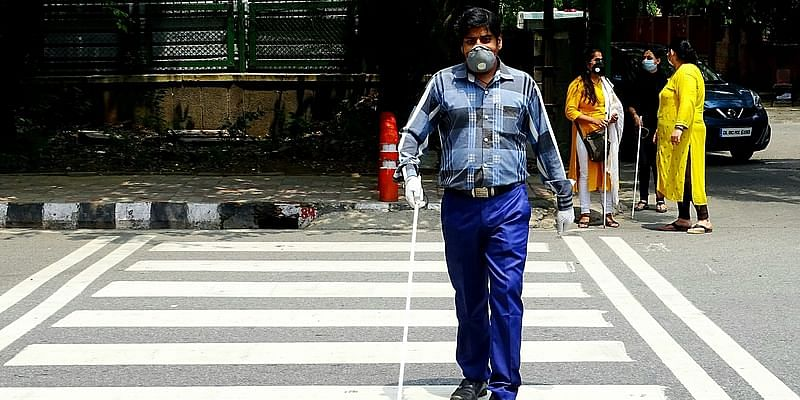 Visually impaired person crossing the street