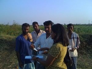 Deepa working on ground with the Fasal Team