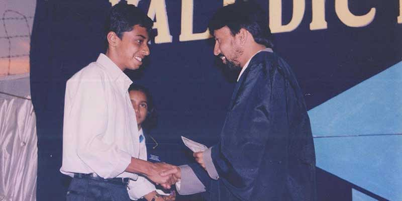Harsha receiving award for scoring 100/100 in most subjects