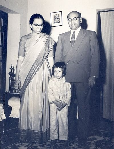 Kiran with her parents as a child