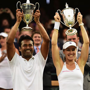 Leander Paes and Martina Hingis with Wimbledon trophy