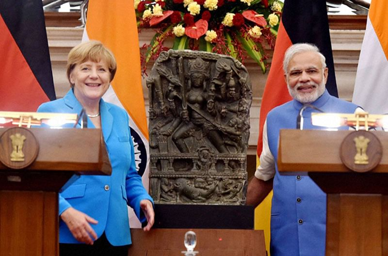 German Chancellor with PM Modi and the recovered Durga. (Pic courtesy IPP)