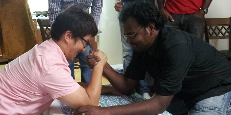 Arm wrestling with a colleague