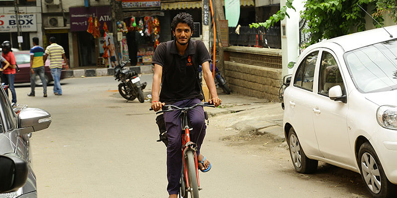 Abhi delivers on his bicycle.