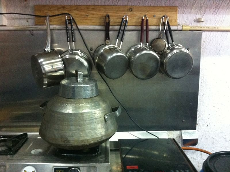 The neatly-arranged pots and pan tell a happy tale.