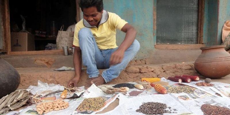 Aadi Kumbruka with various types of legumes, millets, oilseeds and corns grown on his farm.