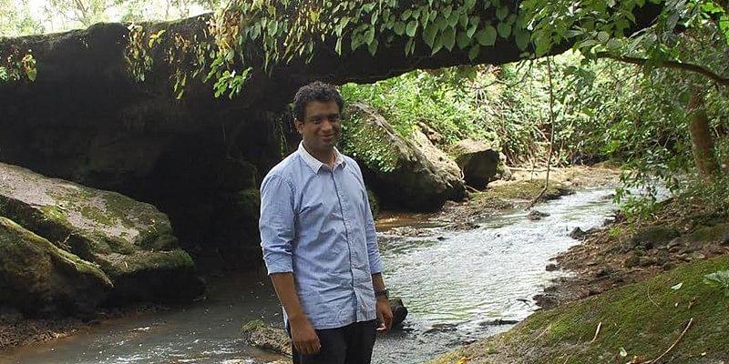 Nivedith Alva, Coastal Development Authority chairman stands at the water's edge in a remote hamlet in Siddapura, Karnataka.