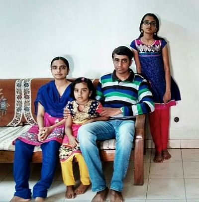 Leena with her husband and daughters