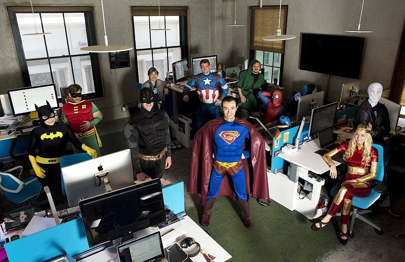 Hello team dressed as superheroes