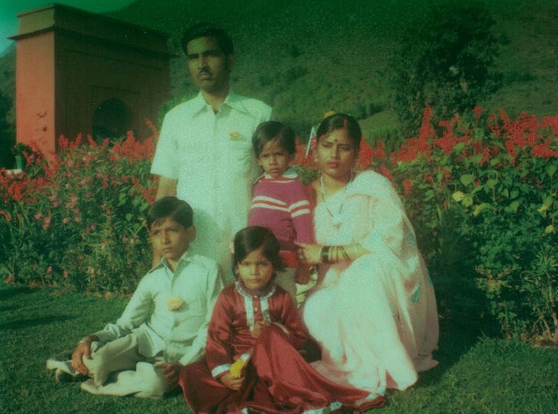 With parents and siblings