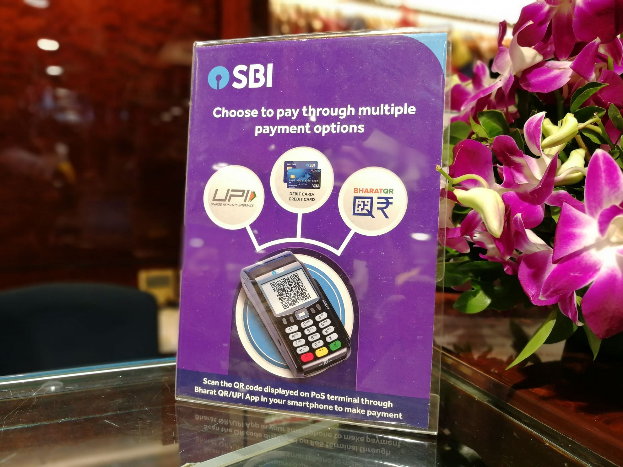 SBI launches multi-option payment device, looks to