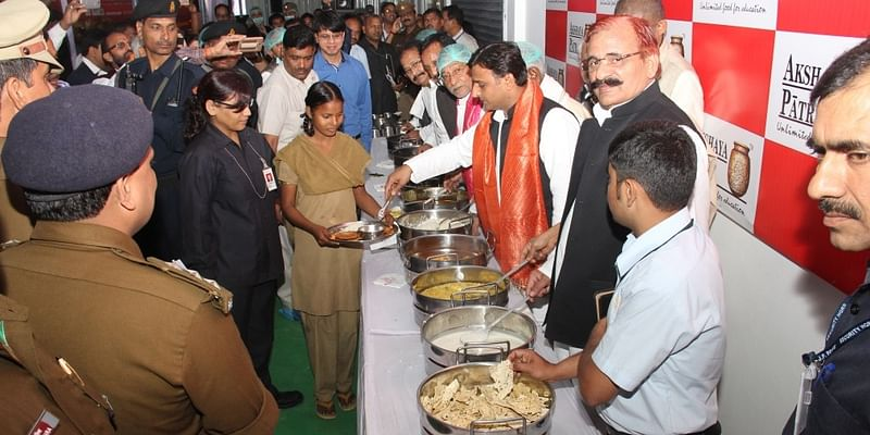 UP CM Serving Mid-Day Meal