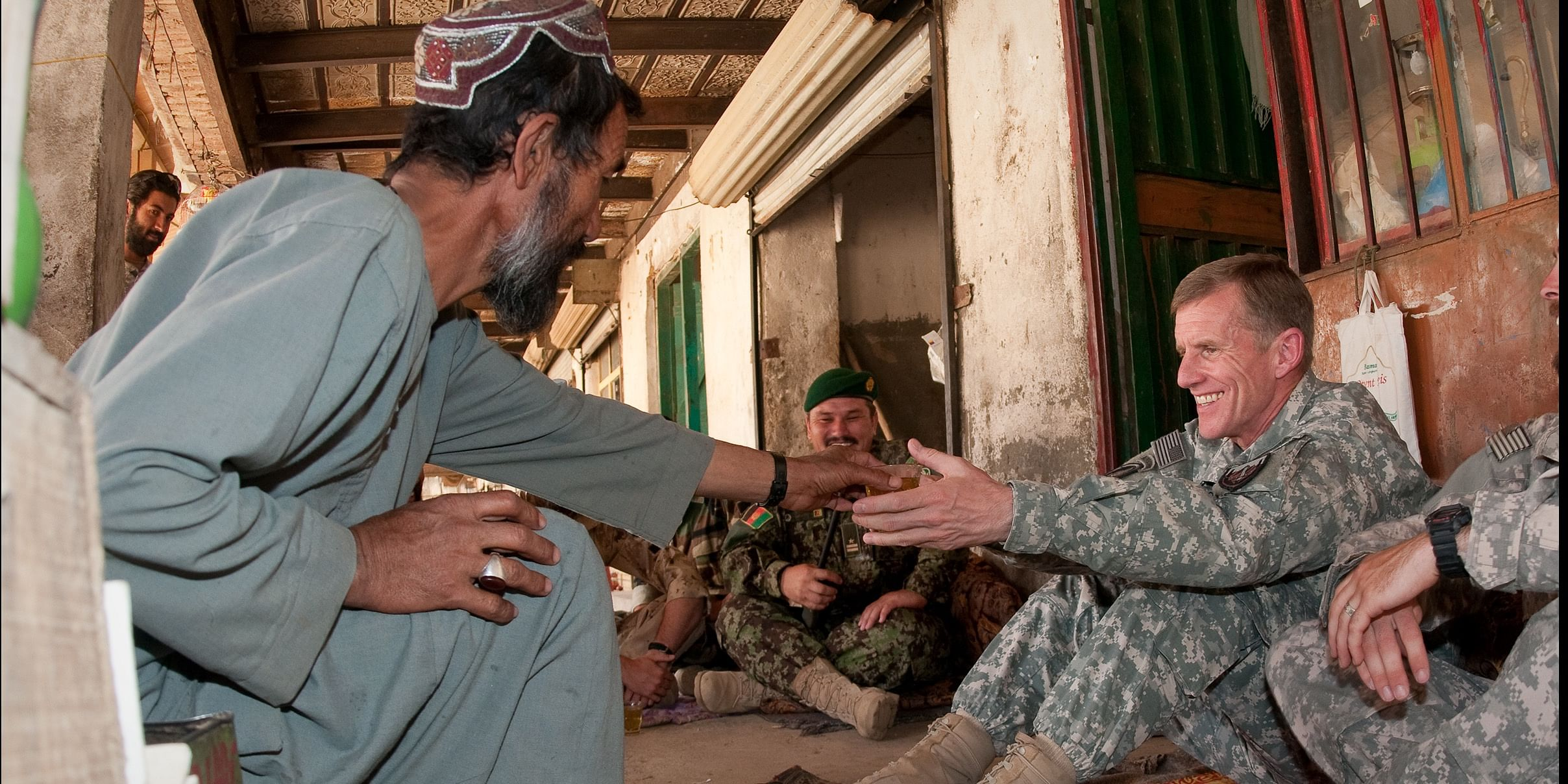 An Afghan old men serve Tea to a US army man, Afghans known the most Hospitable people. Hospitality is a heritage for them.