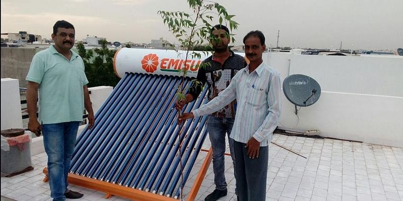 Gifting Plant sapling to our Client Shri. Ashwinbhai on installation of Solar Water Heater at his Residence in Gandhidham.