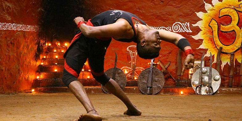 Figure 1 A Kalaripayatu artist in action. Picture courtesy, the artists of Mudra Kalari Center