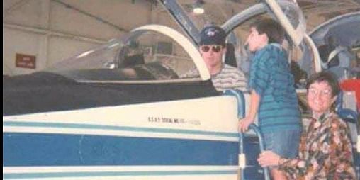 (Nick on the ladder with Katie and his brother-in-law Scott Reagan, the pilot)