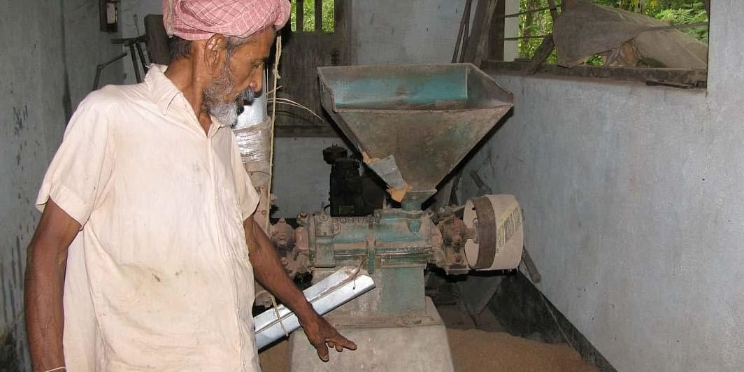 Deva Rao with his 40-year-old Huller (a diesel run machine used to separate the husk from the rice).  Parts of the  Huller are 70 years old.