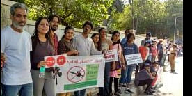 A human chain formed by the citizens of Bangalore protesting the Proposal of the Steel Flyover by cutting down 600 trees.<br>