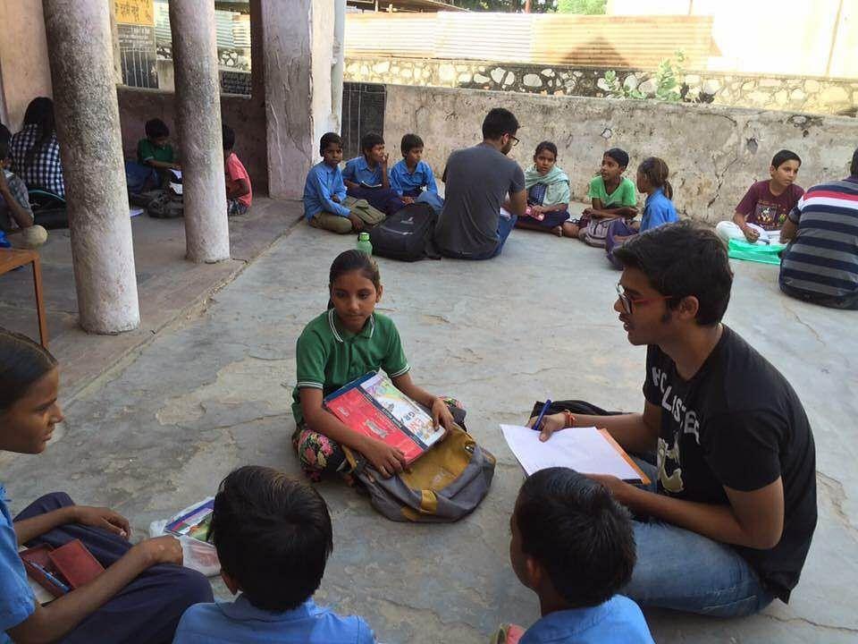 A Team of Gram Vikas educating the children at Government School premises.