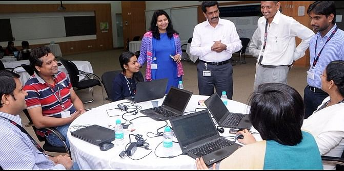 Interns Participating in a Code Fest and Hackathon