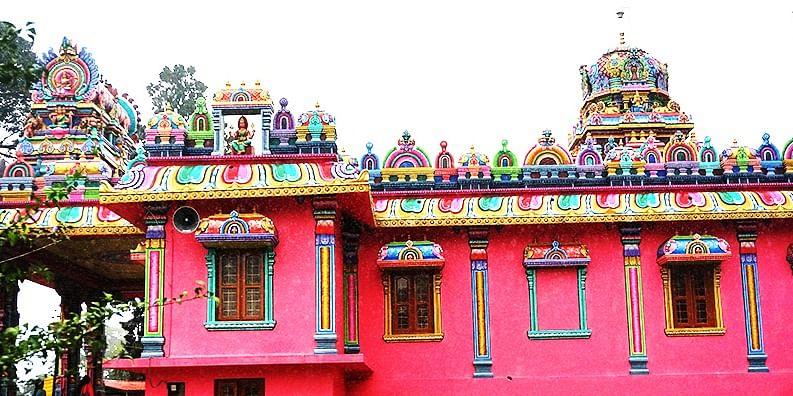Photo #4: It was raining in Coorg and the temple is still so beautiful. I liked to appreciate how intense the pink color was.