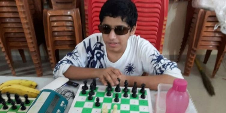 Aryan playing chess