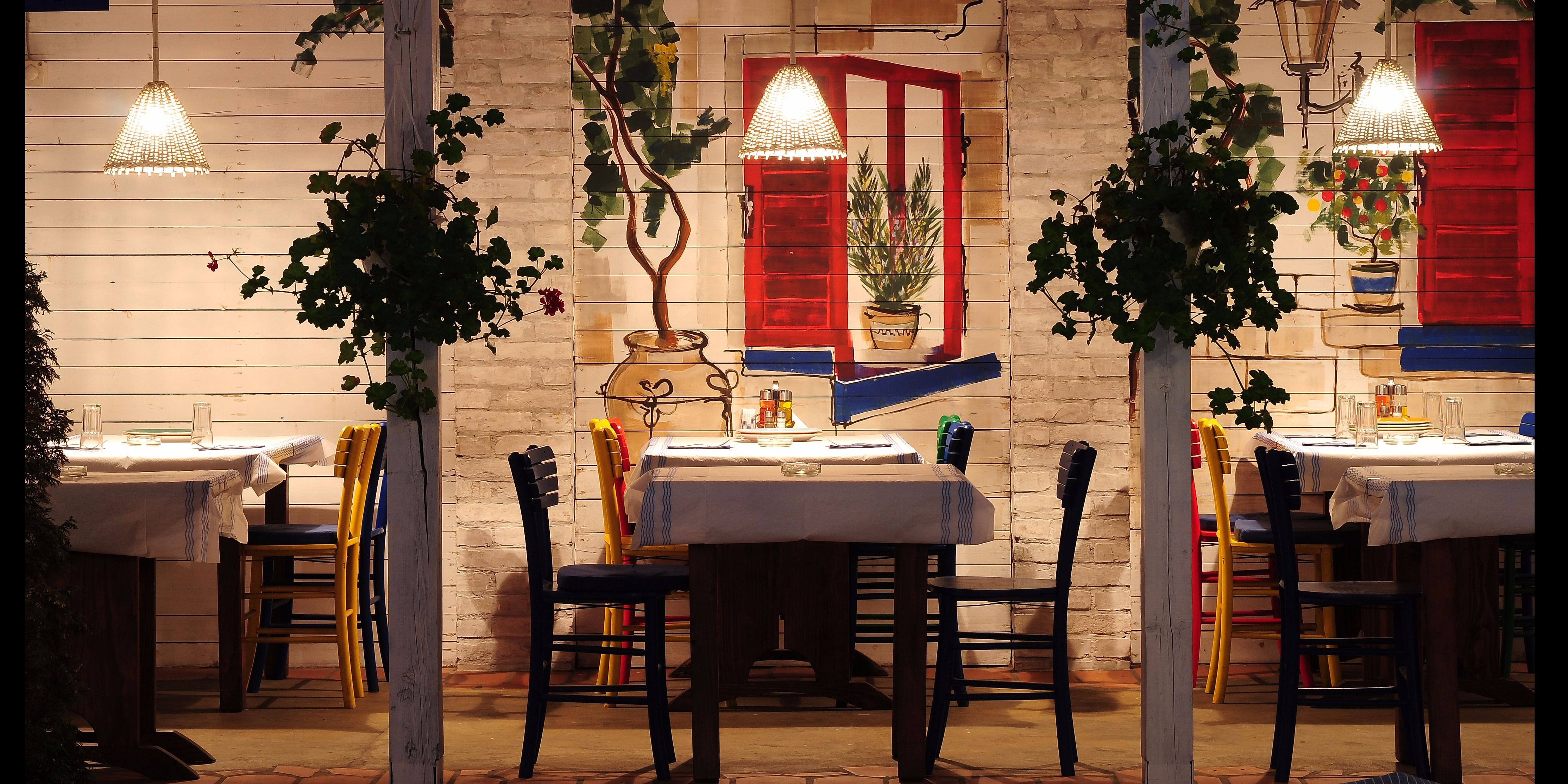 The design of this Greek themed restaurant suggests that the owner is dedicated to promoting Mediterranean culture and cuisine.