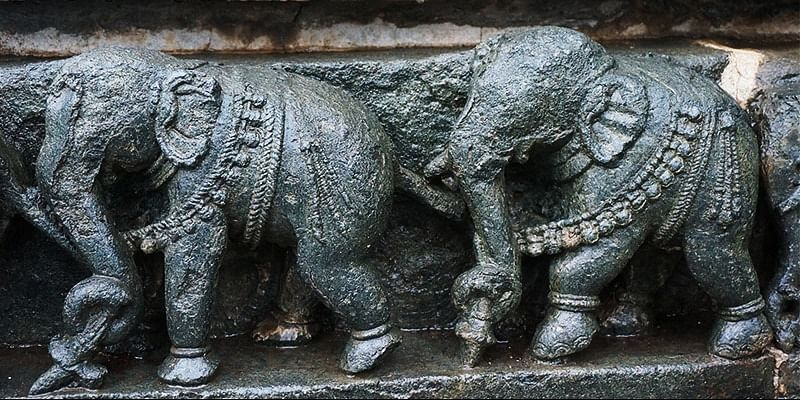 Photo #4: The temples in Belur have scenes of epic elephants carved in stone.