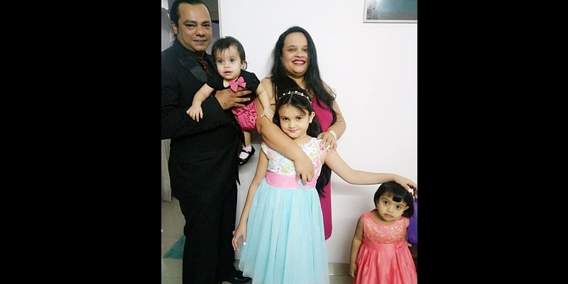 Jennifer and Dexter Ross, with their three princesses