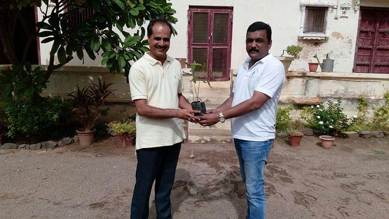 Gifting Plant sapling to Thakore Saheb Krutarthsinhji Jadeja of Devpur (Yax) on installation of Solar Water heater & Solar LED Street Light.