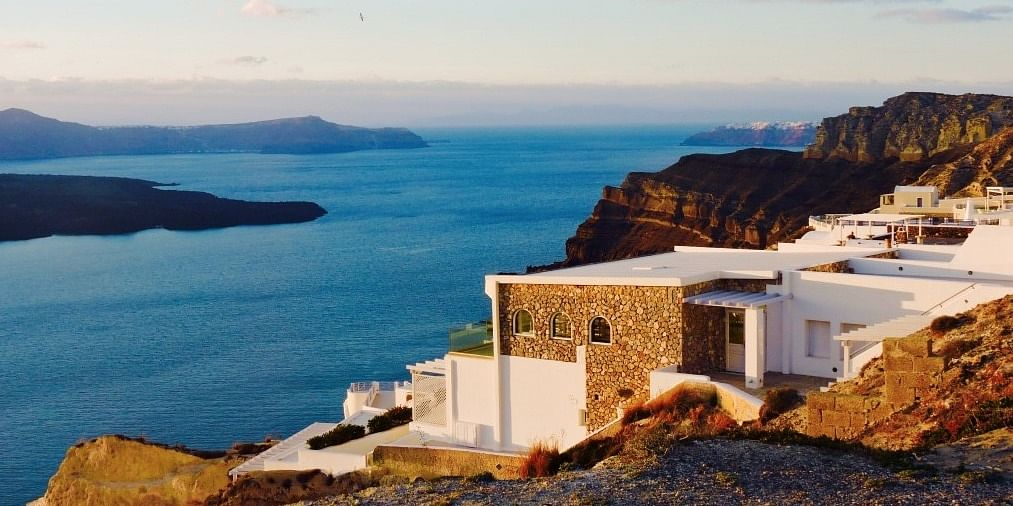 Miss those gorgeous sunset and blue waters of Santorini.