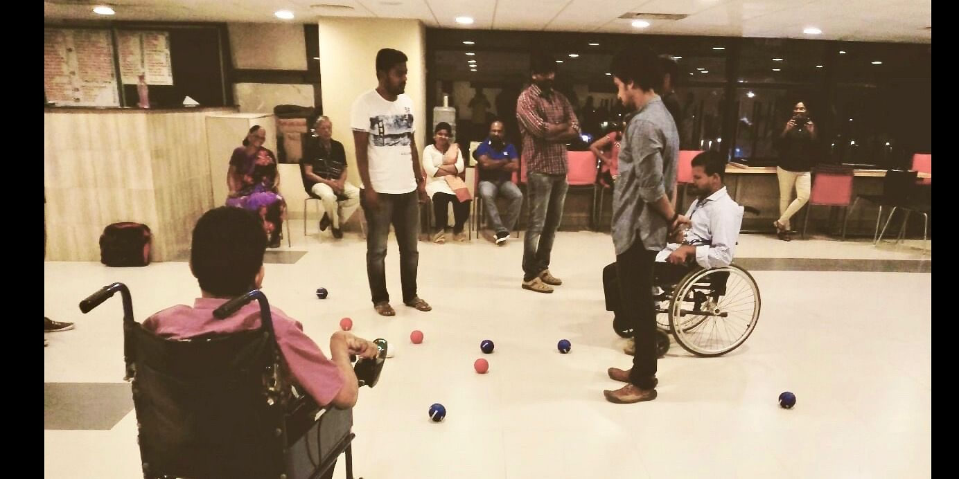 That's Rajiv and myself on the right staring at the boccia balls to evaluate the winner