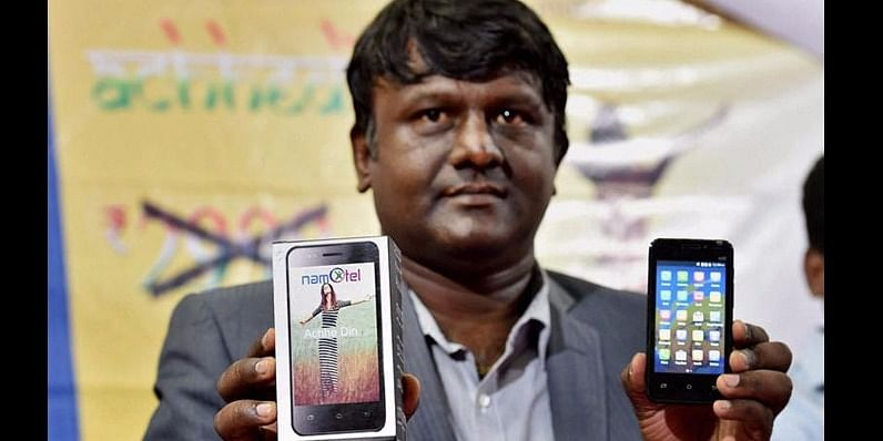 Madhav Reddy from Namotel with the phone