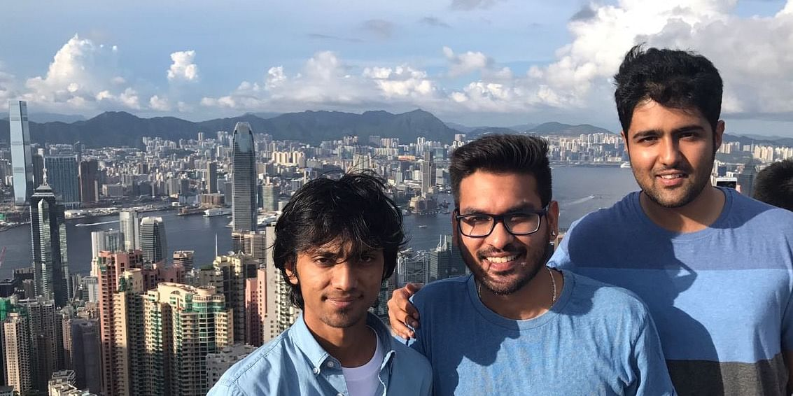 That the three from our team taking that 'touristy picture' at Victoria Peak.
