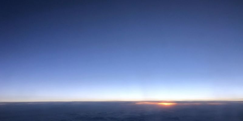 Dawn rising over the pacific ocean. A hop between the two startup hubs pf the world: Bangalore and San Francisco